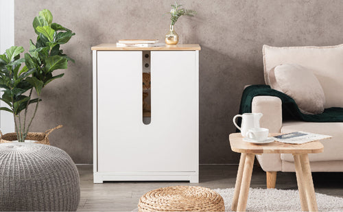 a wooden cat litter cabinet in white color. solid wood made.  the cat litter box put in the living room