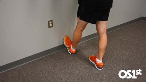 Demonstration of calf stretch that only shoes the lower portion of the body.