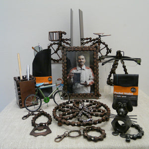 Collection of upcycled bits from bicycles - bike chains, inner tubes, made into glasses case, trivet, book ends, picture frame, penpot, keyrings