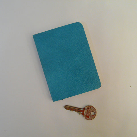 1960-fairtrade-upcycled-cotton-A7-notebook-turquoise-with-key