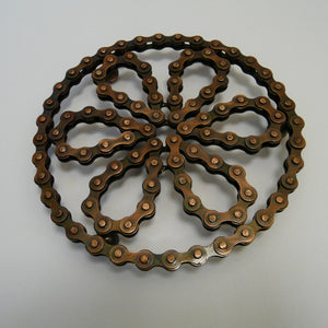 531-fair-trade-upcycled-bronze-brown-bike-bicycle-chain-trivet-flower-shape-cycle