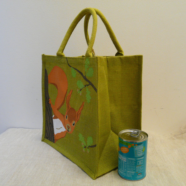 fair-trade-jute-shopping-bag-square-green-squirrel-looking-round-oak-tree-trunk-branches-with-oak-leaves-side-view