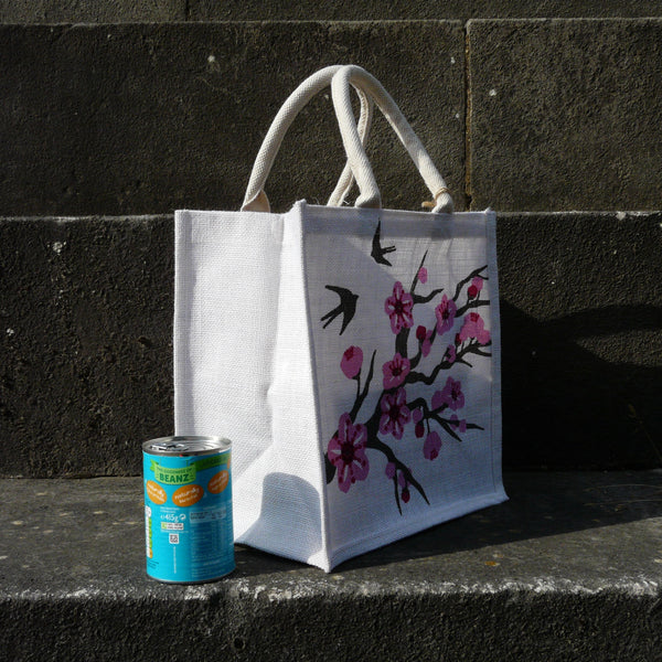 fair-trade-jute-shopping-bag-square-white-pink-cherry-blossom-swallows-sideview