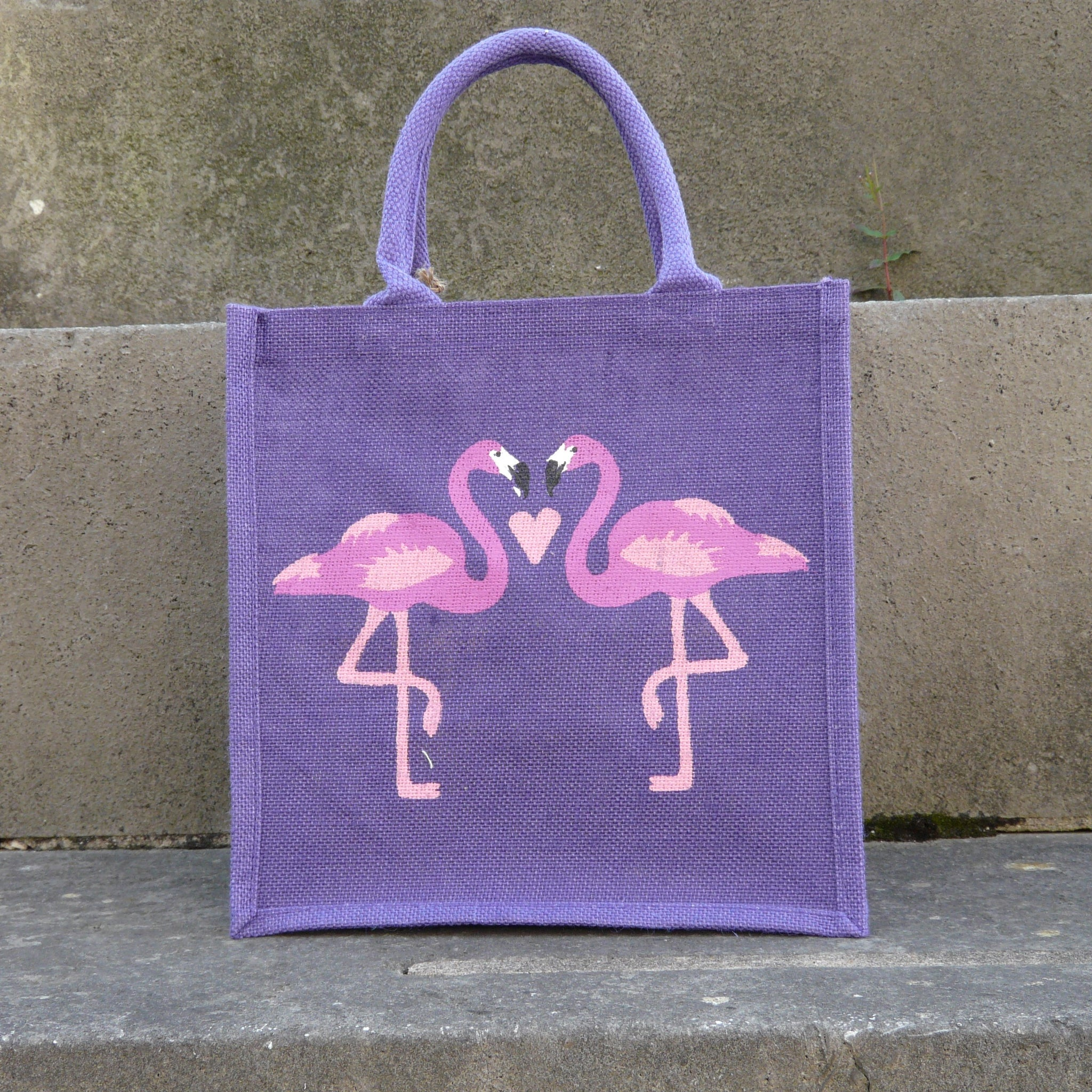 fair-trade-jute-shopping-bag-square-purple-two-pink-flamingoes-facing-with-pink-heart-between