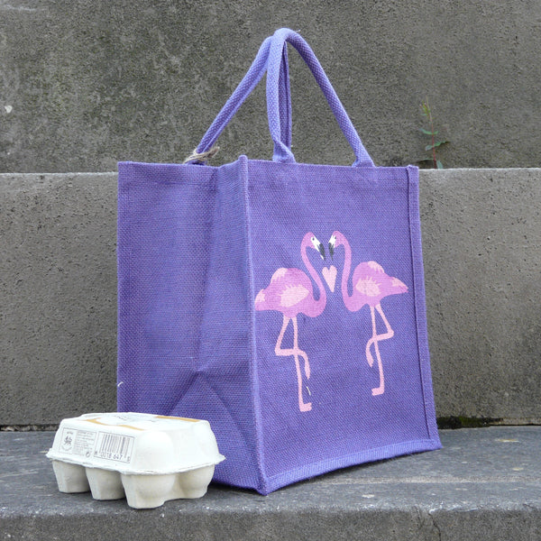 fair-trade-jute-shopping-bag-square-purple-two-pink-flamingoes-facing-with-pink-heart-between-sideview