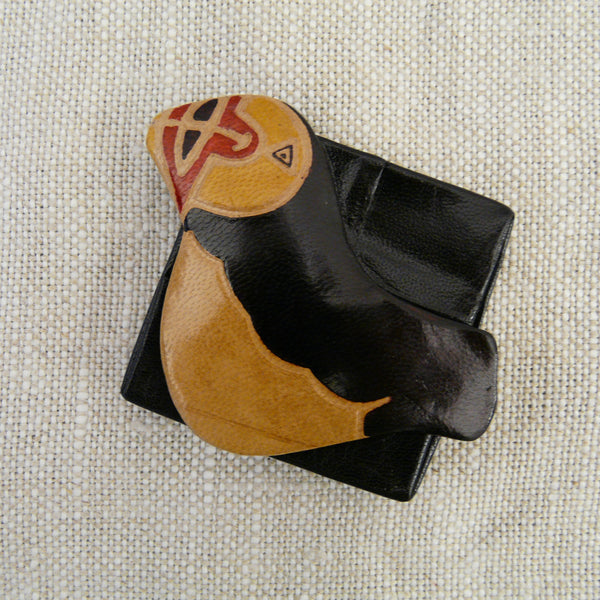 fair-trade-handcrafted-small-leather-coin-purse-puffin-side-view-yellow-head-red-beak-black-natural-body