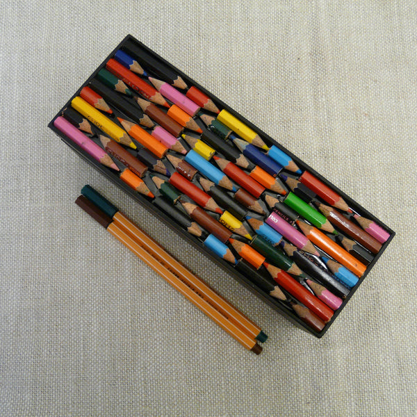 P1110139-Fair-Trade-Upcycled-Crayons-Rectangular-Pencil-Box-Top-view-with-pens