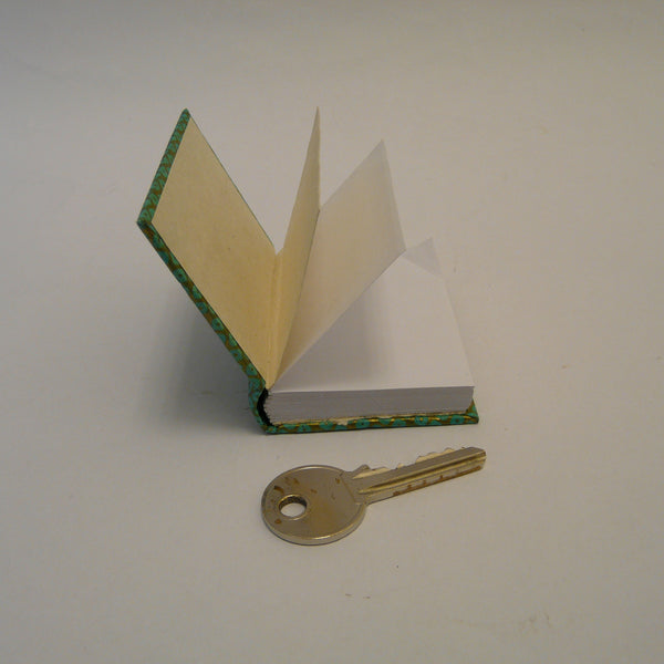 P1110375-fair-trade-lokta-paper-green-mini-notebook-open-with-key