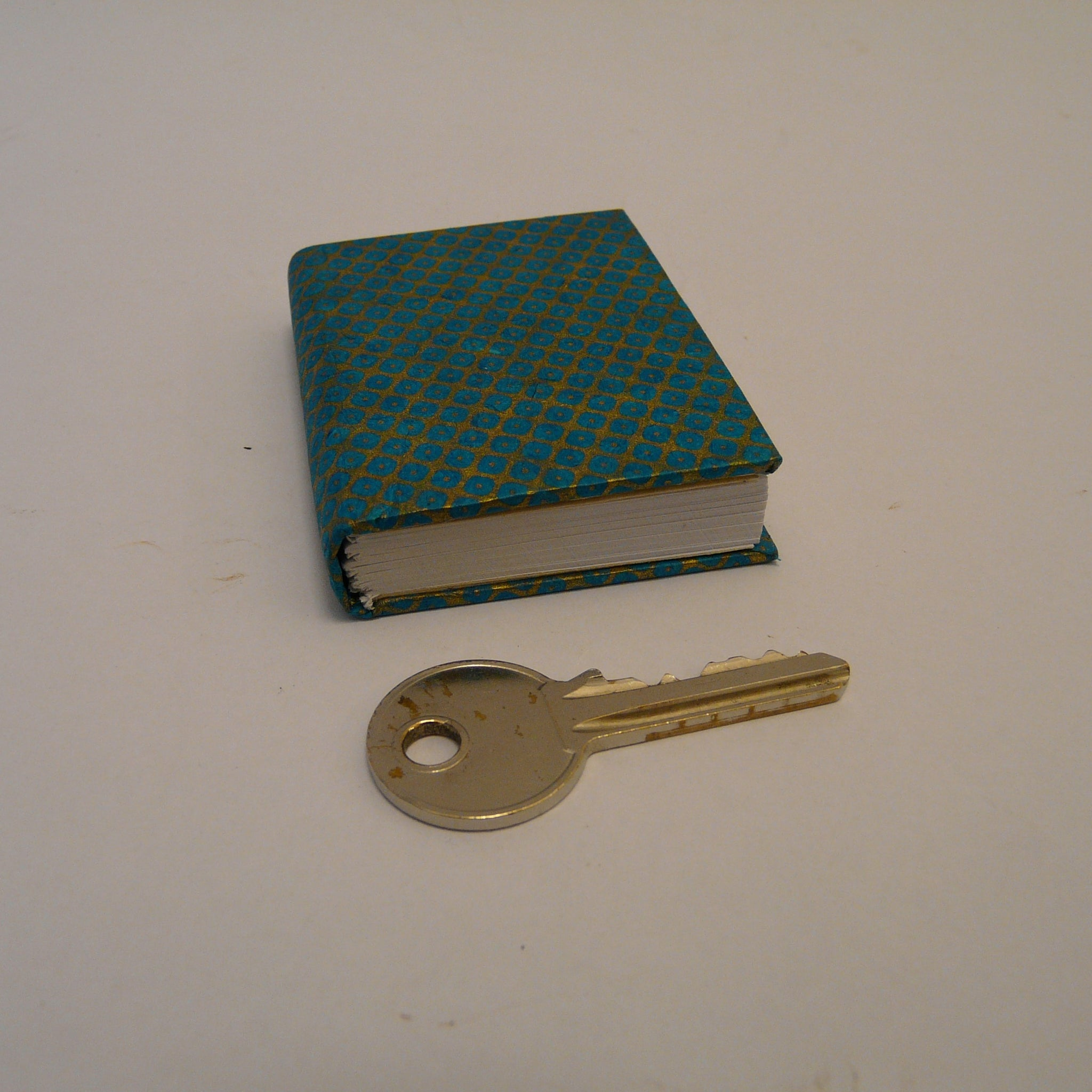 P1110376-fair-trade-lokta-paper-blue-mini-notebook-with-key
