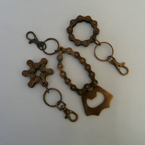 P1110388-fair-trade-upcycled-bike-chain-3-keyrings-star-bottle-opener-circle