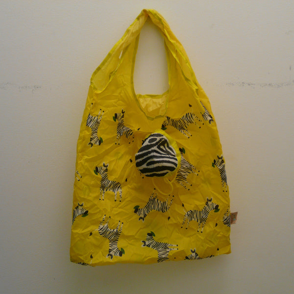 Yellow folding bag made from recycled plastic bottles, Zebra design, with pouch