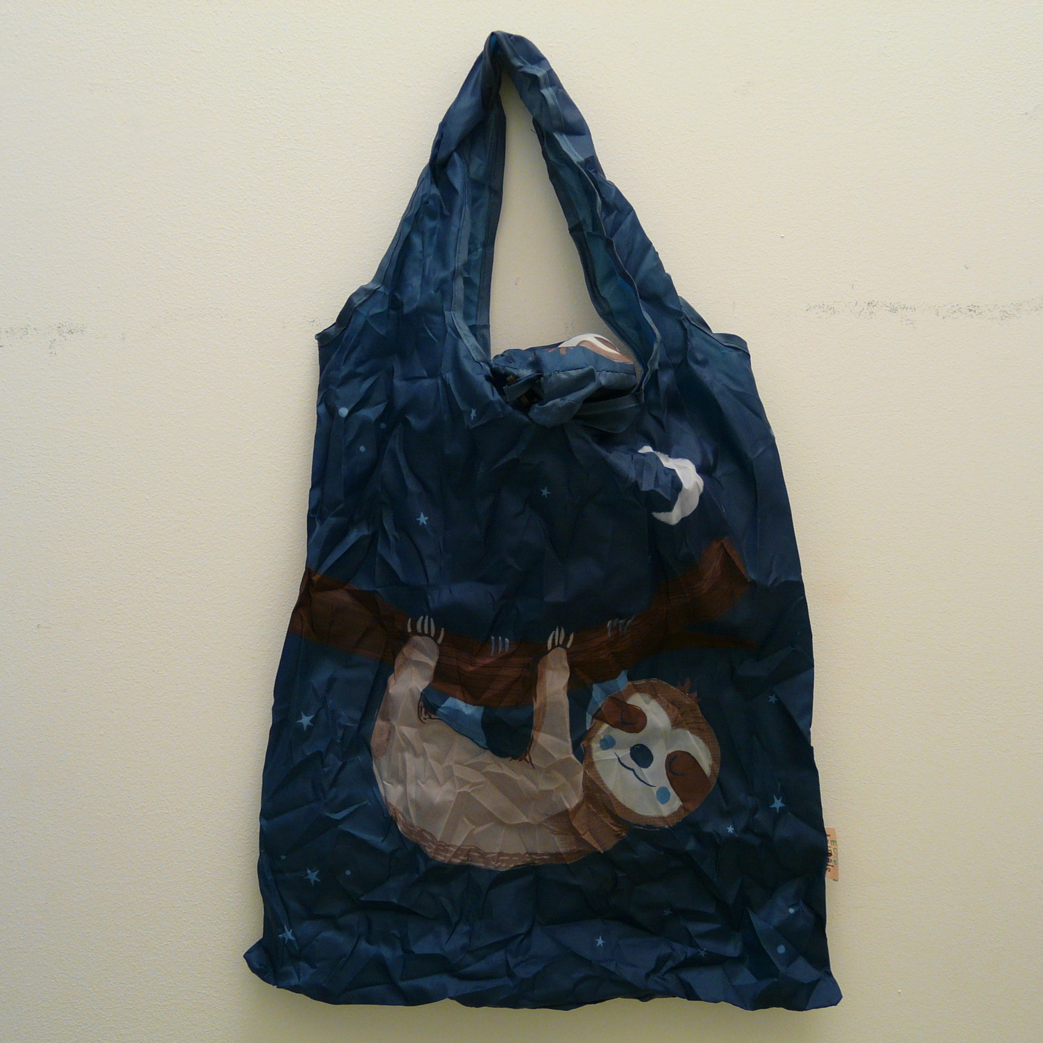Dark blue folding bag made from recycled plastic bottles, Sloth design, with pouch