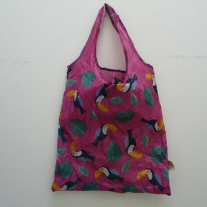 Fuchsia folding bag made from recycled plastic bottles, Toucans and leaves design, with pouch