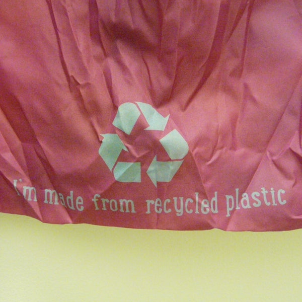Back of bag showing Recycled symbol and 'I'm made from recycled plastic' detail
