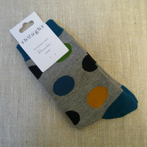 Grey-socks-decorated-with-large-spots-in-navy-blue-mid-blue-green-and-yellow-with-blue-heels-toes-and-tops