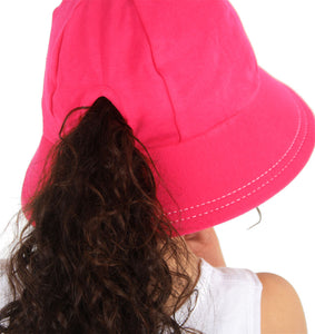 The back of a bright pink hat showing a girls ponytail coming through the ponytail slit in the back of the bucket hat. This hat is made by bedhead hats