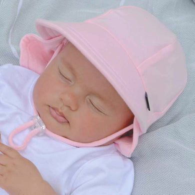baby wearing a pink cap that has excellent sun protection