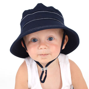 young boy wearing a bedhead kids bucket hat in a navy blue colour