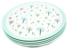 A set of four Ecocubs plant based dinner plates. They are 25cm in diameter and have a white background with an aqua blue rim. They are made of bamboo and this photo shows the four plates stacked on top of each other.
