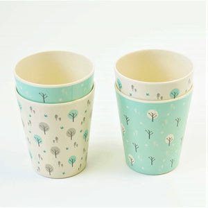 A set of four kid size Ecocubs tumbler cups. These cups are made from bamboo and are 100% plant based, Two of the cups have an aqua blue background and two cups are white.