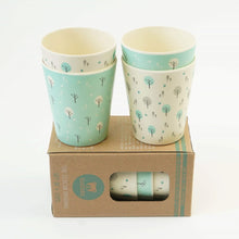 Load image into Gallery viewer, A set of four kid size Ecocubs tumbler cups. These cups are made from bamboo and are 100% plant based, Two of the cups have an aqua blue background and two cups are white. This photo also shows the cardboard packaging.