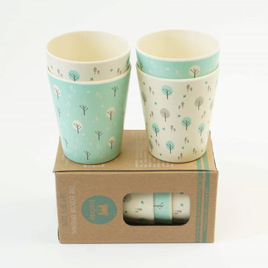 A set of four kid size Ecocubs tumbler cups. These cups are made from bamboo and are 100% plant based, Two of the cups have an aqua blue background and two cups are white. This photo also shows the cardboard packaging.