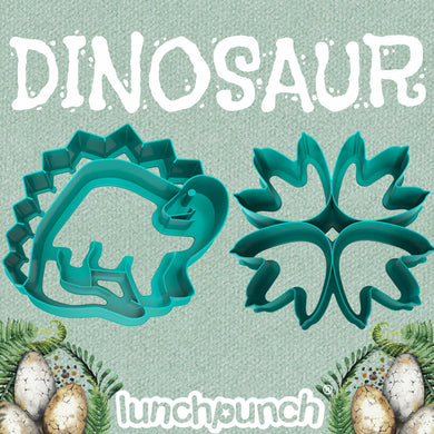 A large dinosaur sandwich cutter and a dinosaur footprint sandwich cutter both made from green plastic by Lunch Punch