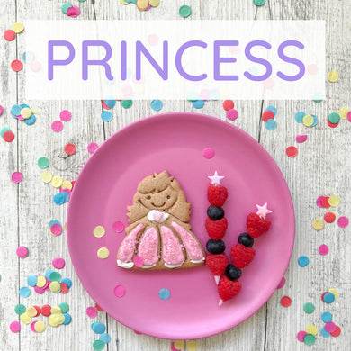 A plate that has a sandwich cut into a princess shape by a lunch punch sandwich cutter
