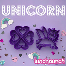 Load image into Gallery viewer, two sandwich cutters made by lunchpunch one is a quad heart shape the other is a unicorn