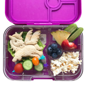 a lunch box with yummy snacks and food including a sandwich that has been cut into a unicorn shape by a lunchpunch sandwich cutter