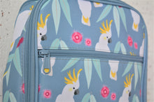 Load image into Gallery viewer, A MontiiCo insulated lunch bag in a cockatoo print which has sulpher crested cockatoos, gum leaves and pink gum blossoms on a slate, blue background. This is a close up view of the design and the zipper on the front pocket.
