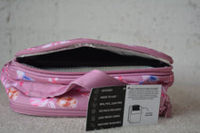Load image into Gallery viewer, A MontiiCo insulated lunch bag in a fairy print which has fairies with a pink dress and pink wings and brown hair in a bun, blue birds flying, pink bows and pink hearts on a pink background. The picture shows you the back pocket open, which is a separate compartment for the included ice pack.