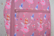 Load image into Gallery viewer, A MontiiCo insulated lunch bag in a fairy print which has fairies with a pink dress and pink wings and brown hair in a bun, blue birds flying, pink bows and pink hearts on a pink background. This is a close up view of the zipper on the front pocket and the design.