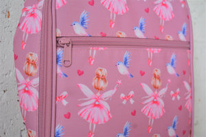 A MontiiCo insulated lunch bag in a fairy print which has fairies with a pink dress and pink wings and brown hair in a bun, blue birds flying, pink bows and pink hearts on a pink background. This is a close up view of the zipper on the front pocket and the design.