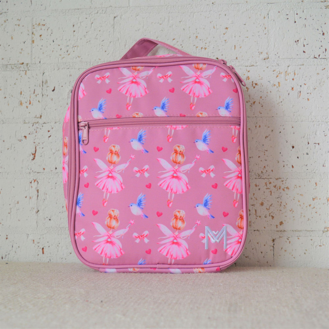 A MontiiCo insulated lunch bag in a fairy print which has fairies with a pink dress and pink wings and brown hair in a bun, blue birds flying, pink bows and pink hearts on a pink background. This is the front view.