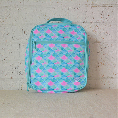 A MontiiCo insulated lunch bag in Mermaid design that features a mermaid tail scales in shimmering pink, blue and aqua colours. This is the front view.