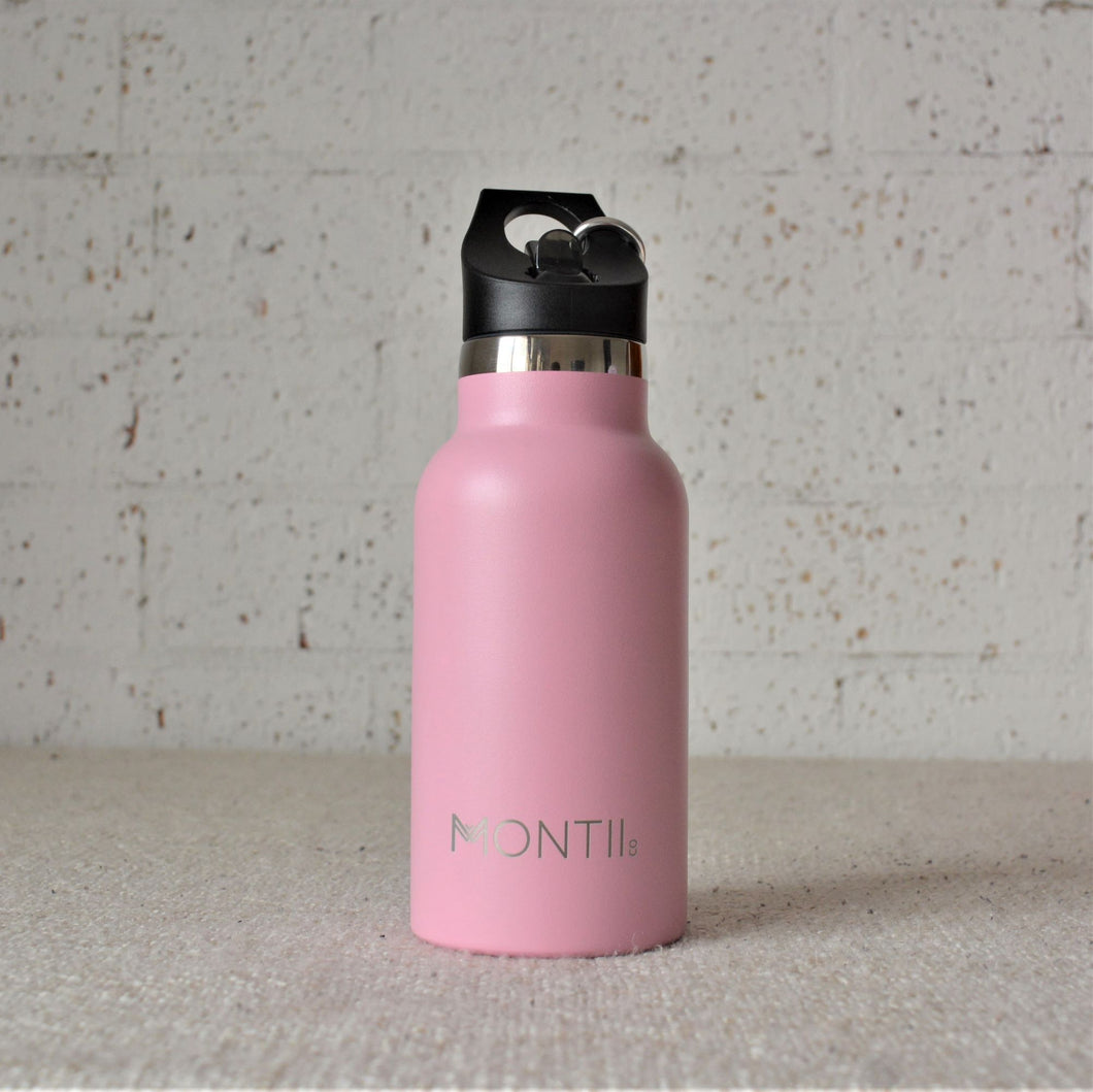 A Montiico double walled stainless steel insulated mini drink bottle in dusty pink with a black easy sip lip