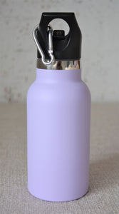 A girl holding a Montiico double walled stainless steel insulated mini drink bottle in lavender with a black easy sip lip