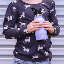 Load image into Gallery viewer, A girl holding a  Montiico double walled stainless steel insulated mini drink bottle in lavender with a black easy sip lip
