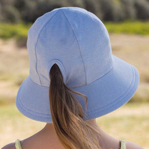 Bedhead hats. Girls ponytail bucket hat in chambray light blue cotton stretch fabric that is UPF 50+. Gumnut Kids is an online Bedhead hat stockist and specialises in Australiana gifts for young children.