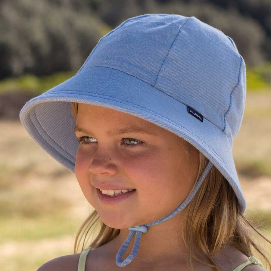 Bedhead hats. Girls ponytail bucket hat in chambray light blue cotton stretch fabric that is UPF 50+. Gumnut Kids is a Bedhead hats stockist based in Berowra, NSW.