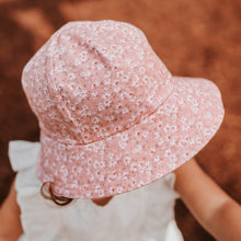 Load image into Gallery viewer, Bedhead hats. Bedhead toddler bucket hat in Sophia, with white flowers on a pink background. This print is from the Bedhead hats Winter 2021 collection and sold by Gumnut Kids, online Bedhead hat stockist in Berowra, NSW.