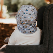 Load image into Gallery viewer, Bedhead hats. Bedhead baby legionnaire hat in trains print, with blue and brown trains on a grey background, from the Bedhead Winter Originals 2021 collection, sold by Gumnut Kids.