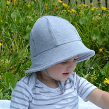 Load image into Gallery viewer, a toddler boy wearing a grey baby bucket hat by Bedhead hats