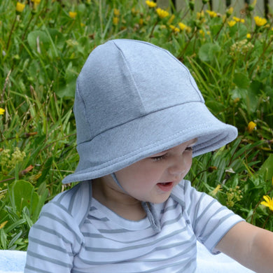 a toddler boy wearing a grey baby bucket hat by Bedhead hats