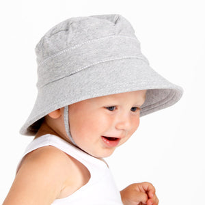young boy wearing a grey bucket hat made by bedhead hats