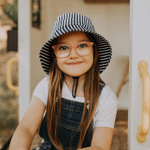 A girl wearing a Bedhead hats Kids bucket hat in Rope, sold by Gumnut Kids, Bedhead hat stockist online, based in Berowra NSW.