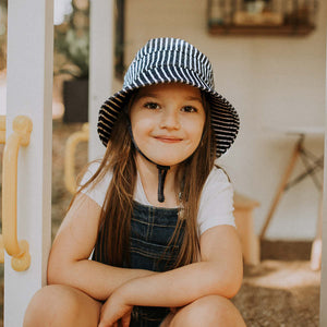 A girl wearing a Bedhead hats bucket hat in Rope print, sold by Gumnut Kids, Sydney online Bedhead hat retailer.