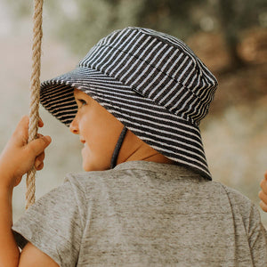 Bedhead hats. Bedhead unisex bucket hat in rope. Gorgeous dark blue background with a white rope stripe print on the stretch cotton UPF50+ fabric.