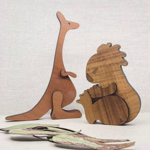 Buttonworks koala and kangaroo wooden sculpture for Australian theme baby nursery.
